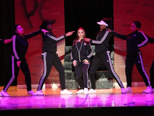 Nicole Minson, center, performing in Paramus Catholic