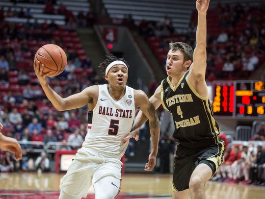 Western Michigan's Jared Printy (No. 4) defends Ball State's Ishmael El-Amin during a men's basketball game Feb. 23, 2018, in Muncie, Indiana.