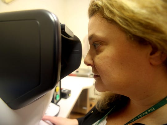 Andrea Sullivan, Occupational Therapy Supervisor for Outpatient Services at Burke Rehabilitation Hospital in White Plains, demonstrates a device used to measure visual acuity, depth perception, and peripheral vision Feb. 23, 2018. Sullivan's department evaluates elderly drivers to measure if they're abilities have deteriorated. Drivers who have experienced physical issues such as strokes are also evaluated.