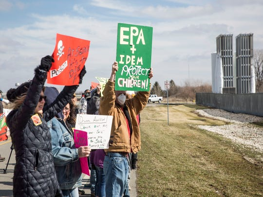 Environmental activists protest in front of the Exide Technologies lead smelter in Muncie in this file photo.