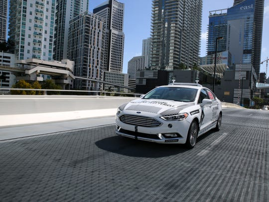 Ford and its partners — Domino's Pizza, ride-hailing