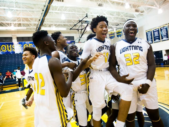 The Lehigh boys basketball team celebrates after defeating