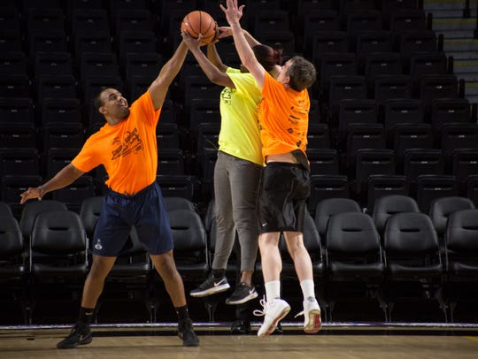 Gov. Ralph Northam jumps for the ball during the Capitol