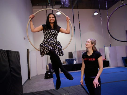 Lohud's Swapna Venugopal Ramaswamy climbs up an aerial hoop -- known as lyra --  under the watchful eyes of Hilary Sweeney, owner of Westchester Circus Arts in Ardsley on Feb. 26, 2018.
