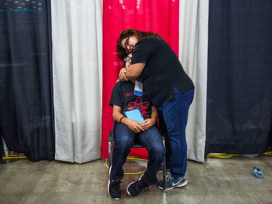 Evelyn Amoros hugs her nephew Marc Rivera, 14, at the