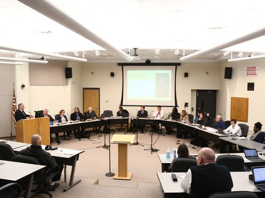 The Beacon City School District board listens to a presentation by Ron Mackey, director of transportation, during a meeting at Beacon High School on Feb. 26, 2018.