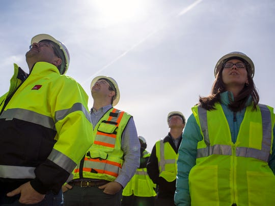 Sentry Insurance employees watch as the final steel