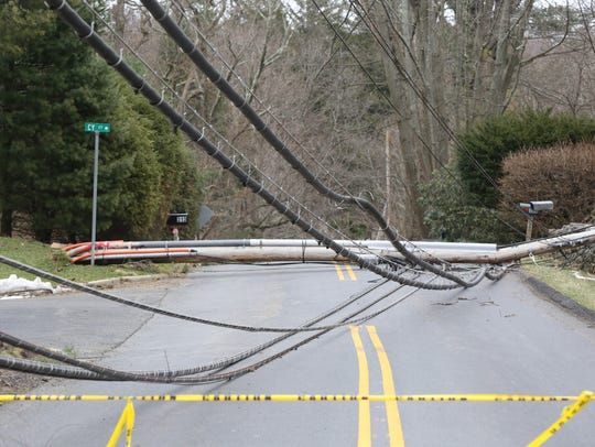 A view of down utility pole on Lake Street near Cy