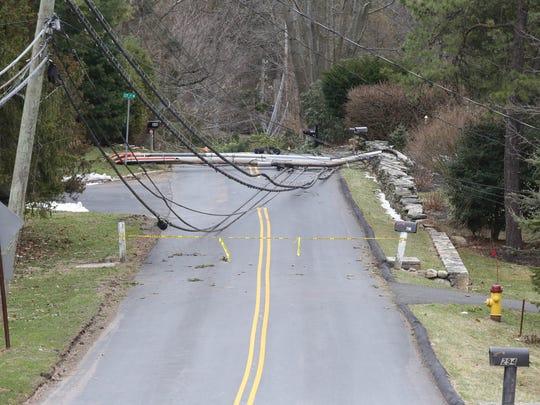 A view of down utility pole on Lake Street near Cy