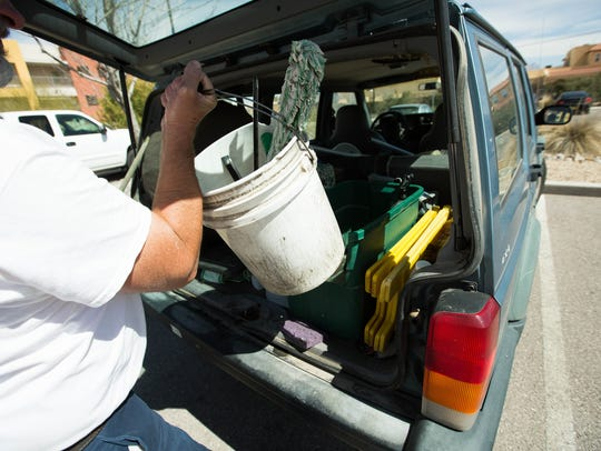Bruce Carson loads his truck with all the needed supplies for a job. Carson's Window Service has about 150 clients in the Las Cruces area. March 6, 2018.