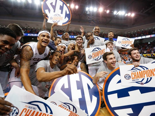 Auburn celebrates its 79-70 win against South Carolina to capture an SEC regular-season title on March 3, 2018.