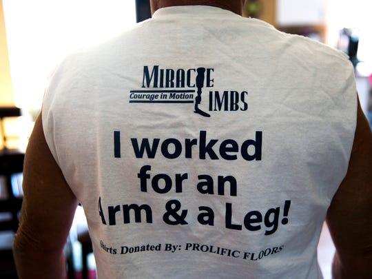 Curt Robidoux wears his Miracle Limbs volunteer shirt
