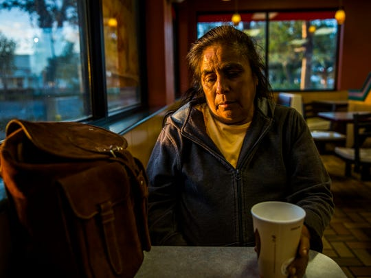 "Jesusita ""Susanna"" Rodriquez has a cup of coffee at Burger King as the sun rises in Immokalee on Thursday, March 8, 2018. Rodriquez says she leaves her camp every morning before sunrise to avoid confrontation with authorities, who have warned her against trespassing in the past."