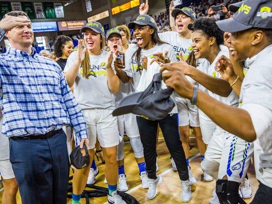 The FGCU women's basketball team celebrates winning