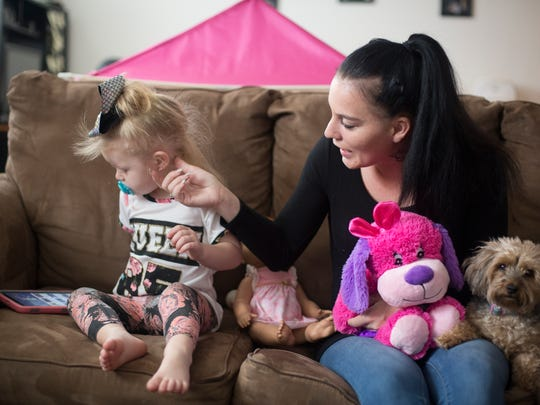 Monday, March 12, 2018: Meichelle Hunley tries to get the attention of Ava, 2. Hunley adopted Ava after she was diagnosed with Neonatal Abstinence Syndrome. A new study from Cincinnati Children's Hospital Medical Center shows that newbornsÊtreated for opioid withdrawal are at higher risk than others to experienceÊdelayed language, cognitive and motor skills. Ava, is about about a year-and-a-half behind in her speech, but has no problem with motor skills and is very smart, Hunley said. The Enquirer/Carrie Cochran