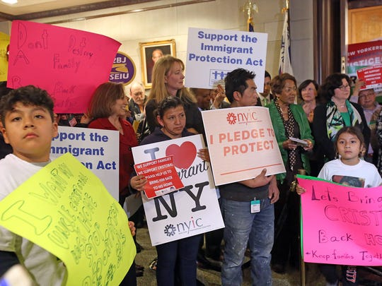 Local lawmakers and activists attend a rally for the