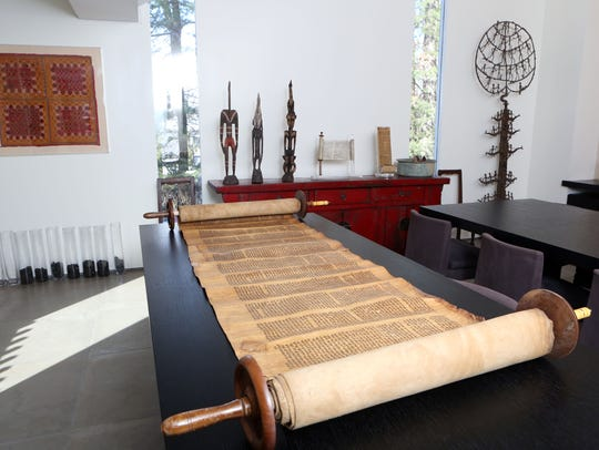 An ancient torah displayed at the home of Varda Singer