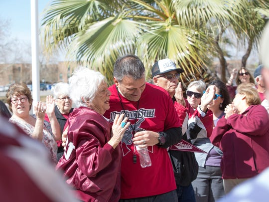 Chris Jans, right, talks to Barbara Hubbard,left, during a morning sendoff rally at the Pan American Center as the team gets ready to leave for the NCAA tournament. Wednesday March 14, 2018.