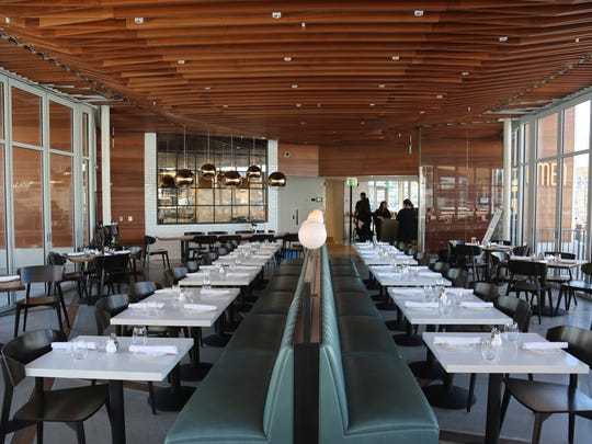 Surrounded by floor-to-ceiling glass panels that open completely in warm weather, the main dining room at Lumen is bisected by an iridescent light-blue banquette studded with globe lighting. The flagship restaurant of the newly constructed Beacon Park in downtown Detroit is set to debut the first week of April.