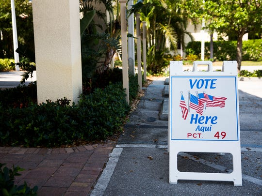 Signs point in the direction of the polls during the 2018 Bonita Springs City Council elections on Tuesday, March 20, 2018 at precinct 49, St. Leo Catholic Church in Bonita Springs. Laura Carr and Rick Steinmeyer ran against each other in the race for the District 3 seat.