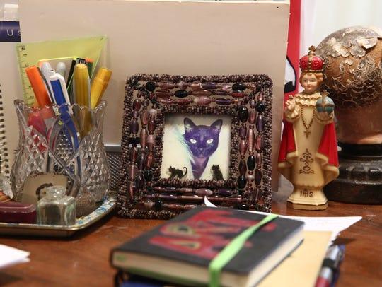 Items on sculptor, Suprina Troche's desk at her studio