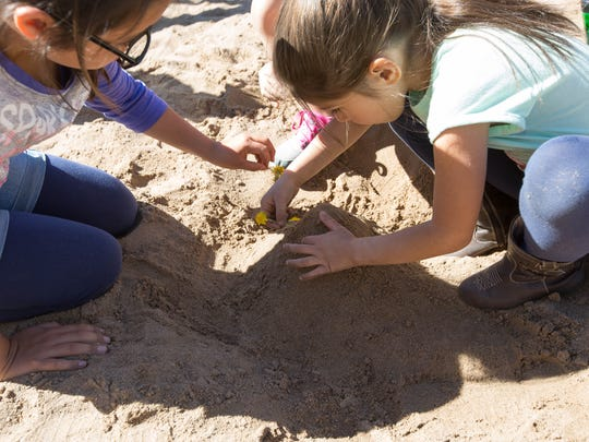 Hope Gonzales, 11, and Marleigh Jimenez, 6, work on decorating a sand castle with help from Jasmine Villanueva, 7, not pictured, Tuesday March 20, 2018 at Frank O'Brien Paper Community Center, during a Spring Break Camp put on by the City of Las Cruces Parks and Recreation.