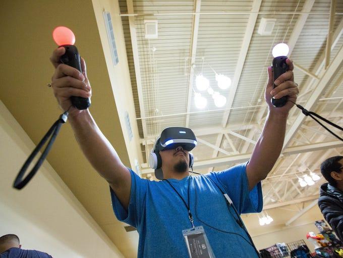 Jesus Jimenez, plays a Virtual Reality version of the