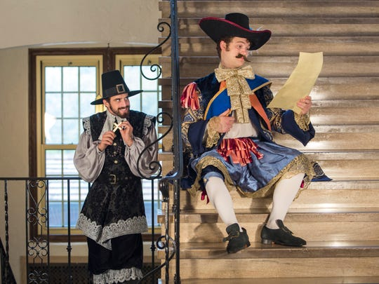 Tartuffe played by Cecil Jennings (in black) and Orgon played by Christian Douglass (in Blue).