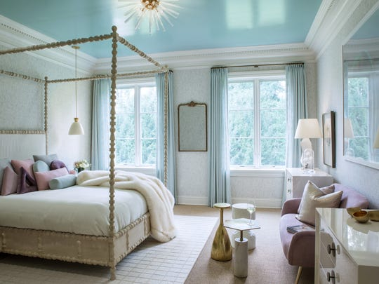 A sitting area elevates the feel of a bedroom to that of a suite, says interior designer Keira St. Claire-Bowery.