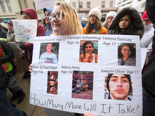 Shelby Powell, 15, from Newport High School, holds a sign with some of the Parkland, Florida victims. Thousands took part in the March For Our Lives rally in downtown Cincinnati, Ohio Saturday afternoon, despite the snowy weather. Students organized the event, which included several speakers, including Ethel Guttenberg, grandmother of Jaime Guttenberg, 14, who was one of the victims at the Marjory Stoneman Douglas High School in Parkland, Florida.