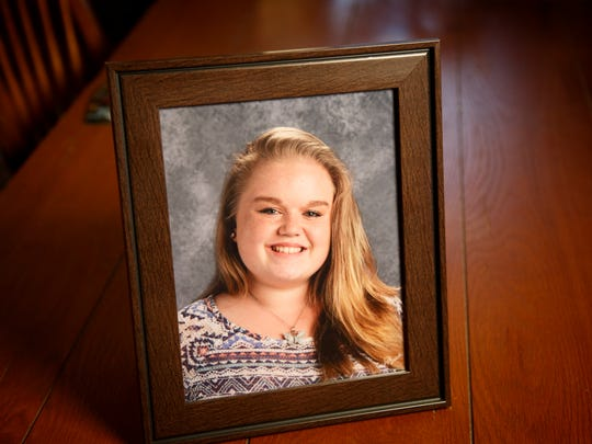A school photo of Megan Klindt. Megan was killed in