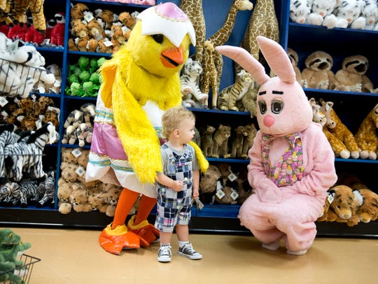 Landon Crowe, 1, takes a closer look at the Easter