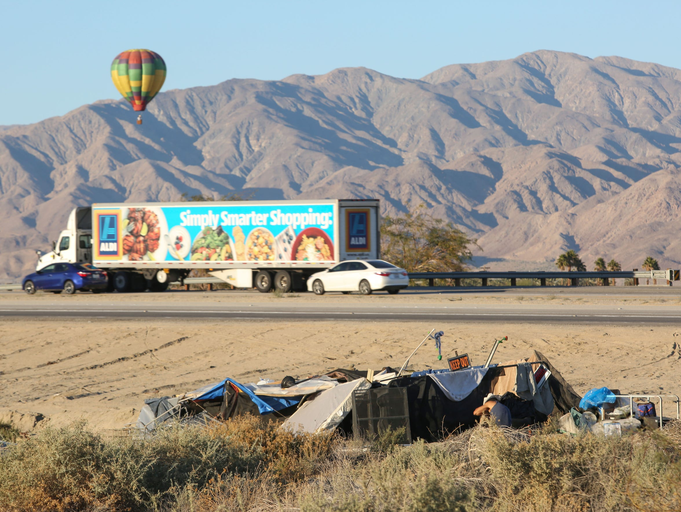 A makeshift home sits on the side of Highway 86 in