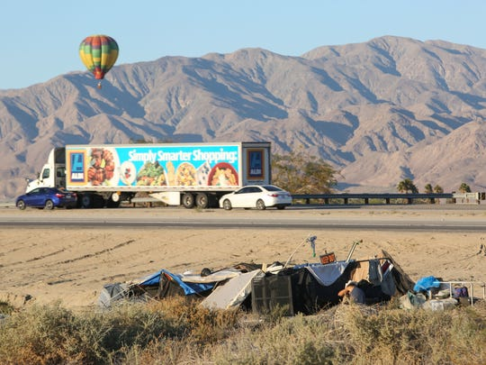 A makeshift home sits on the side of Highway 86 in Coachella where there are dozens of similar homeless camps.