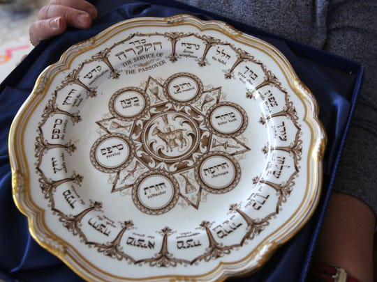 Eileen Grossman holds her Passover Seder plate from the 1920s that belonged to her grandmother at home in New Hempstead March 22, 2018.