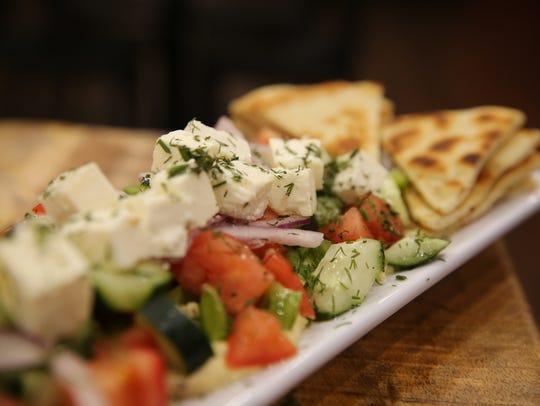 Hummus Horiatiki Salad is a dish served at Tzatziki