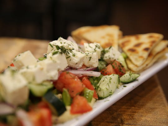 Hummus Horiatiki Salad is a dish served at Tzatziki