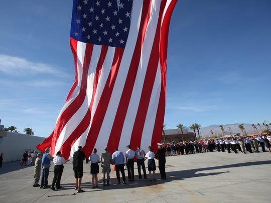 A large flag is raised at the opening of the 8th annual veterans expo. The expo took place at the Riverside County Fair Grounds on April 7, 2018, The event was attended by hundreds and included speeches, music and informational booths for issues pertaining to veterans.