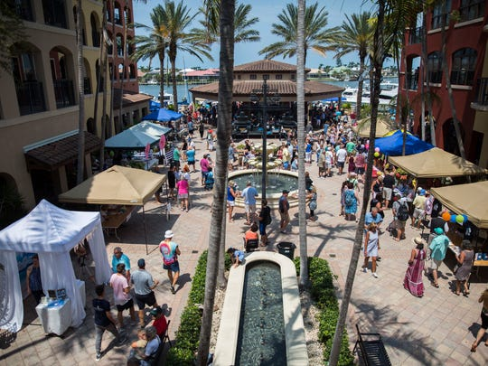 Hundreds of people walk through the 27th Annual Taste of Marco at The Esplanade on Sunday, April 8, 2018.