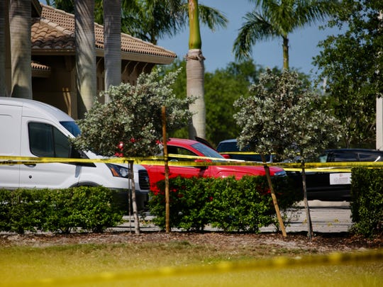 A bullet-ridden red vehicle was found at the scene of a reported homicide at the Galleria in Estero on Tuesday, April 10, 2018.