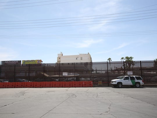A U.S. Border Patrol vehicle is seen parked at the border wall in downtown Calexico on April 10, 2018.