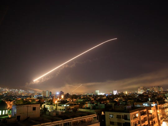 The Damascus sky lights up missile fire as the U.S.