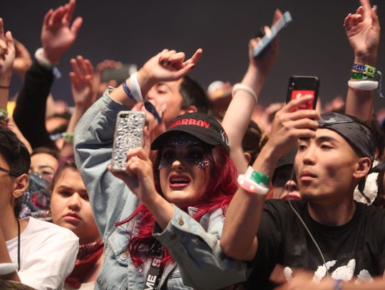 Fans of The Weeknd during their performance on the