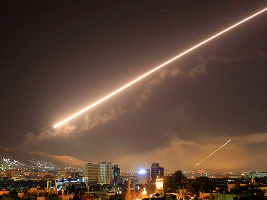 Damascus skies erupt with surface-to-air missile fire as the U.S. launches an attack on Syria targeting different parts of the Syrian capital of Damascus early on April 14, 2018.