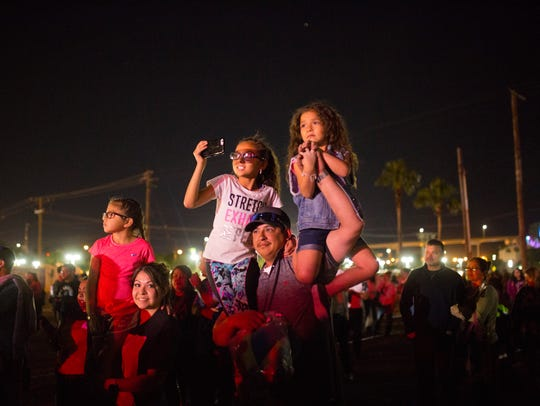 A family listens to music at Fiesta de la Flor on Saturday,