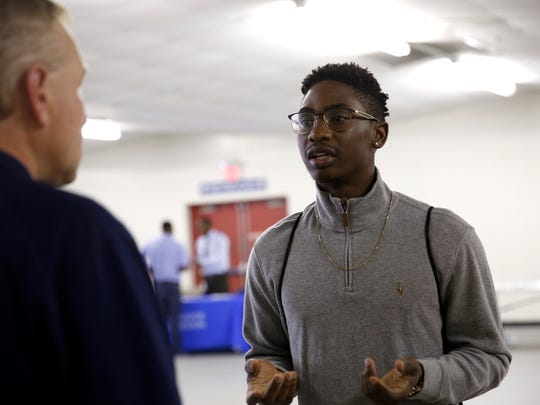 Jephte Chevrin speaks to a potential employer at the Employment and Community Resource Fair held Wednesday at the North Florida Fair Grounds. The fair is hosted by Leon County Probation in collaboration with Florida Department of Corrections and U.S. Probation Office to help people with criminal backgrounds find jobs.