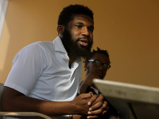 In this April 18, 2018 photo, Rashon Nelson, left, speaks as Donte Robinson, right, looks on during an interview with The Associated Press in Philadelphia. Their arrests at a local Starbucks quickly became a viral video and galvanized people around the country who saw the incident as modern-day racism. In the week since, Nelson and Robinson have met with Starbucks CEO Kevin Johnson and are pushing for lasting changes to ensure that what happened to them doesn't happen to future patrons. (AP Photo/Jacqueline Larma)