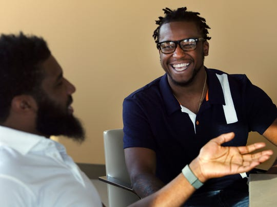 In this Wednesday, April 18, 2018 photo, Rashon Nelson, left, and Donte Robinson, right, laugh during an interview with The Associated Press in Philadelphia. Their arrests at a local Starbucks quickly became a viral video and galvanized people around the country who saw the incident as modern-day racism. In the week since, Nelson and Robinson have met with Starbucks CEO Kevin Johnson and are pushing for lasting changes to ensure that what happened to them doesn't happen to future patrons. (AP Photo/Jacqueline Larma)