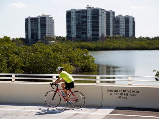 A bike passes over one of the two bridges replaced in the Vanderbilt Drive Bridge Replacements Project Thursday, April 19, 2018 in Naples. The $5.4 million project included the replacement of two bridges along Vanderbilt Drive as well as the reconstruction of the Marina Bay Club intersection, water and waste water main replacements, as well as stormwater drainage updates.