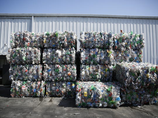 Bales of sorted materials wait to be sent on to mills